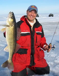 Tony Roach of Roachs Guide Service holds a nice winter ice walleye